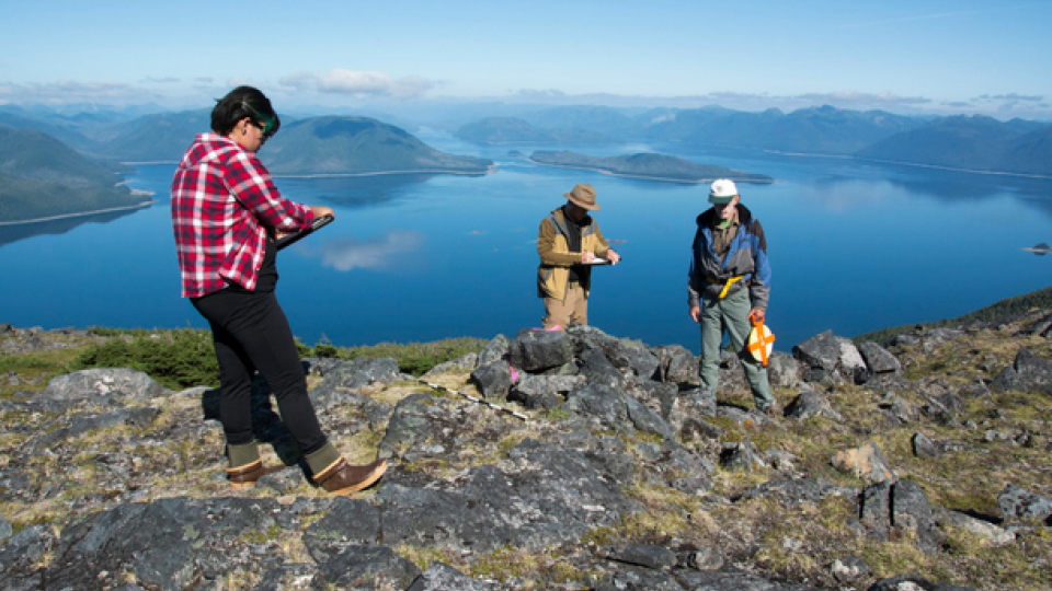 Researchers (from left) Elizabeth Howard, Mike Chondoronek and Ralph Hartley record initial observations of an Alaskan alpine cairn.