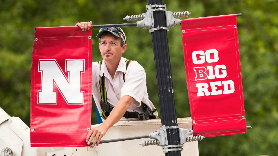 The new Nebraska N is placed on a lamp post along R Street. Starting July 1, the Nebraska N replaced icons used by academic units, Nebraska Athletics and the Nebraska Alumni Association.