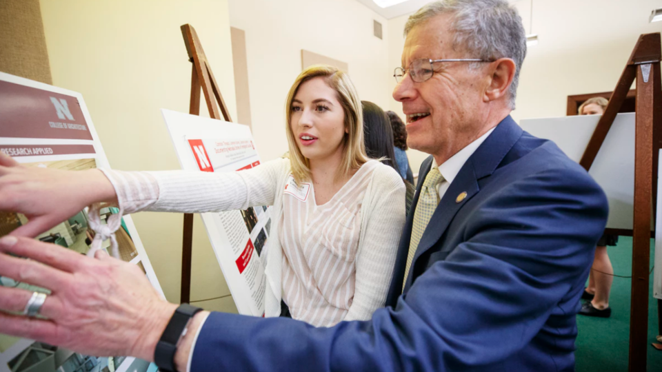 Sen. John S. McCollister and Amanda VanBuren discuss her research on the design of outpatient healthcare facilities.