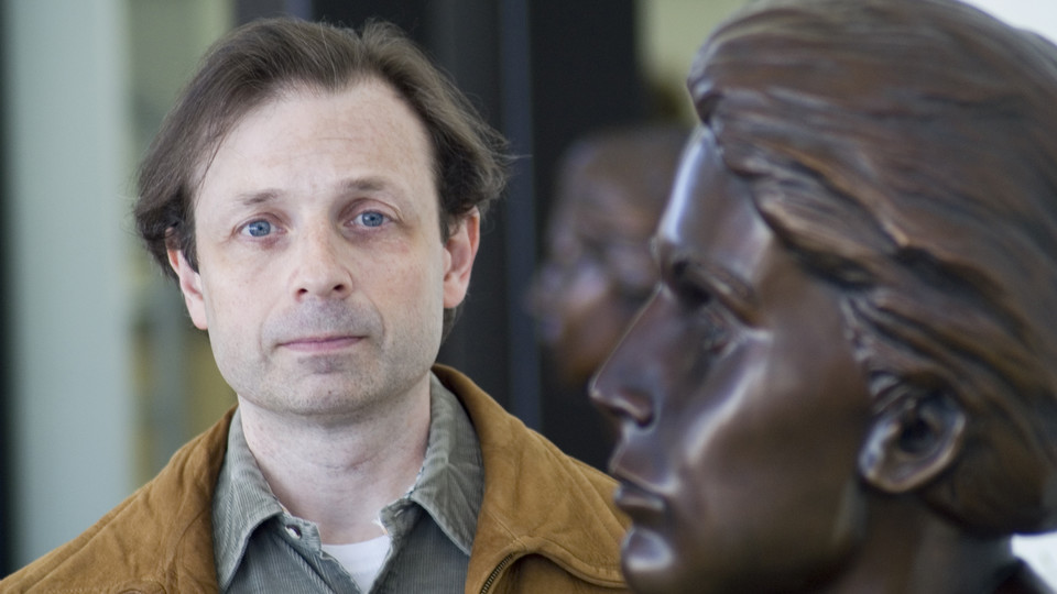 John Sorensen stands next to the bust of Grace Abbott in the entryway of Grand Island's Edith Abbott Memorial Library. Sorensen will discuss the legacy of the Abbott sisters in the March 28 Nebraska Lecture.