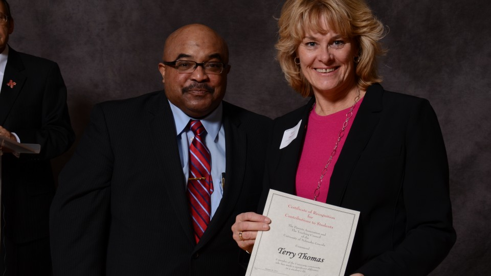 Terry Thomas (right), a volunteer with the University Health Center, receives a contribution to students awards during the 2015 ceremony in the Nebraska Union. The 2016 ceremony is 3 to 5 p.m. Jan. 29 in the Nebraska Union.