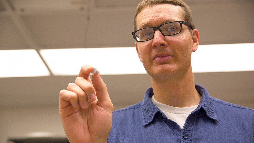 UNL researcher Benjamin Terry holds a prototype of his team's tapeworm-inspired attachment mechanism, which adhered to the wall of a live intestine for six days.