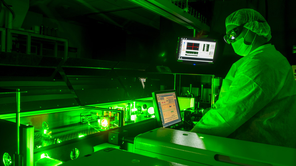 A scientist works with lasers in the Diocles Extreme Light Laboratory.