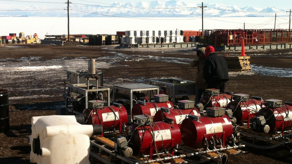 ANDRILL's roving hot water drill is on the ground in Antarctica at McMurdo Station on Ross Island. McMurdo Sound and the Transarctic Mountains on the Antarctic mainland are in the background.
