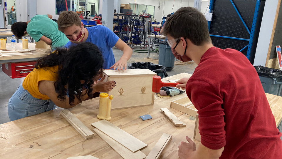 Students assemble toolboxes in Nebraska Innovation Studio Oct. 17. The boxes will be given to the Whiteclay Makerspace.
