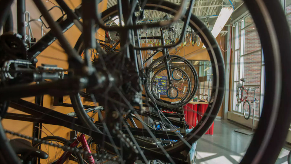 Bikes hang in the Outdoor Adventures Center bike shop. A new community partnership is bringing a bike-share service to campus this spring.