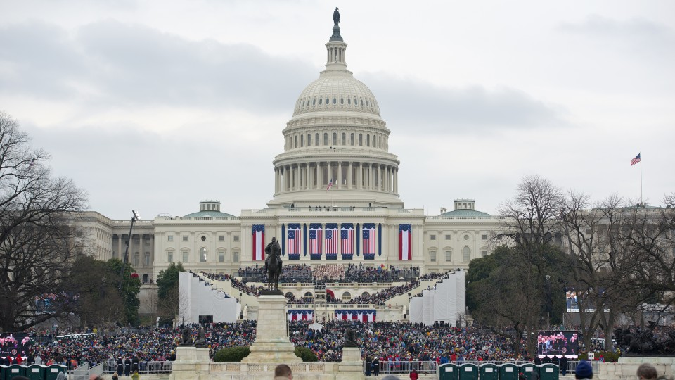 Visitors watch the inauguration of President Donald Trump on Jan. 20 in Washington, D.C. Nebraska's Mario Scalora assisted with threat assessment during the event.