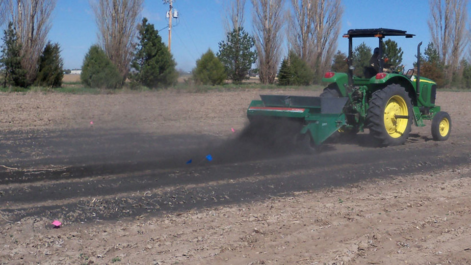 Char is spread onto research plots at the Mitchell Agriculture Lab, which is located north of the University of Nebraska Panhandle Research and Extension Center. Grant funds are available to assist the development of biochar in Nebraska and Kansas.