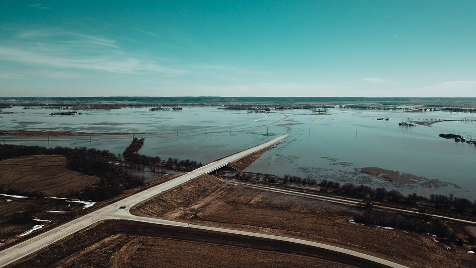 Floodwaters cover roadways near Bellevue last week. As floodwaters begin to recede, the university is offering supports to students, faculty and staff.