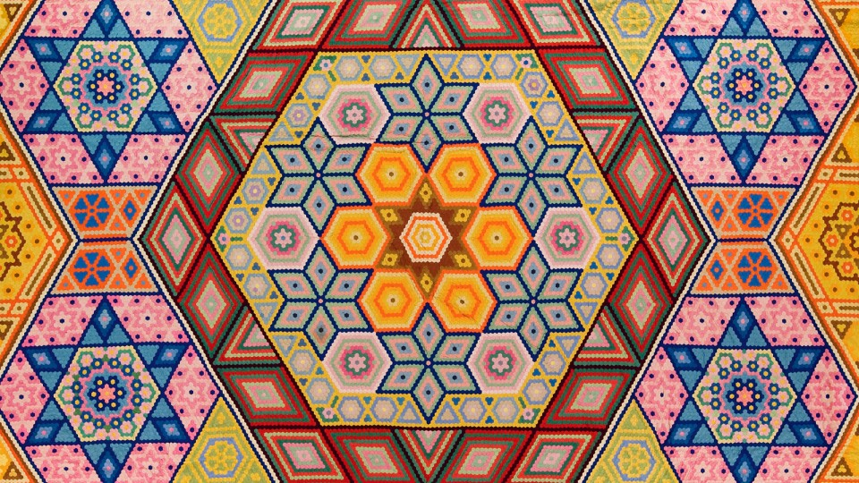 "Grace Snyder's ""Hexagon Mosaic"" quilt, one of her two designs designated among the 100 best 20th-century quilts by Quilters Newsletter Magazine in 1999. She made the quilt in 1940. (Image No. 2009.032.0001)"