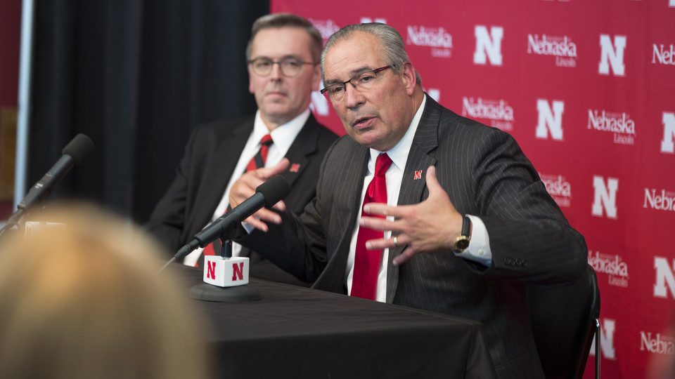 Bill Moos, Nebraska's new director of athletics, talks during an Oct. 15 press conference in Memorial Stadium. The new hire was announced by Chancellor Ronnie Green (left).