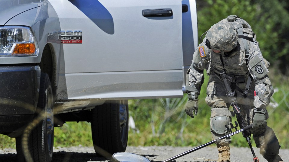 A vehicle is examined at a military checkpoint in this photo from the Department of Defense. The National Strategic Research Institute has earned a $1 million contract to continue its research on improving military checkpoints.