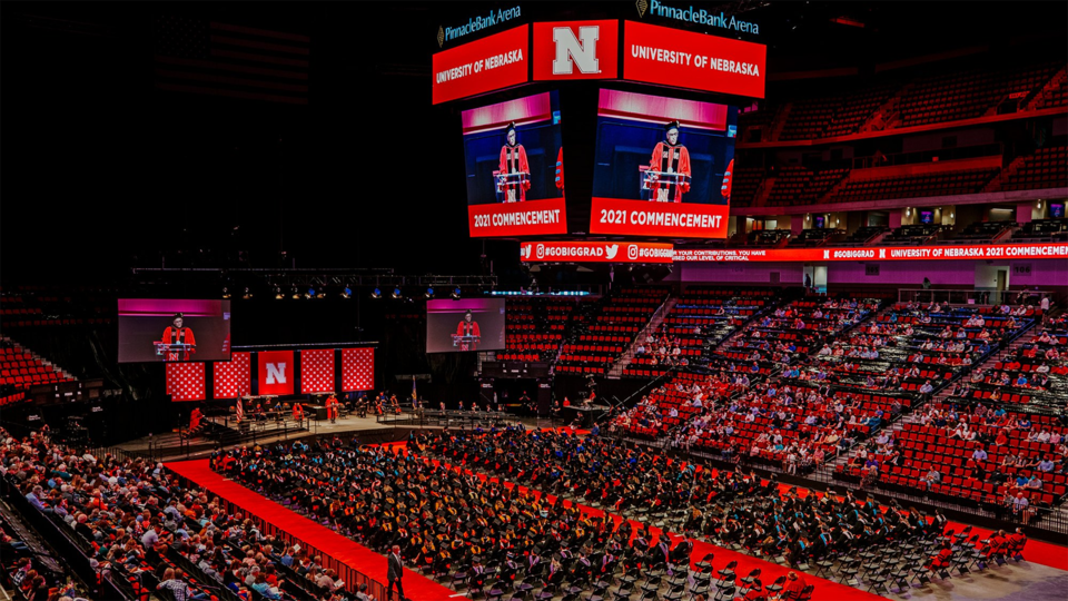 The university will hold August 2021 commencement exercises in Pinnacle Bank Arena, shown here during the graduate ceremony on May 7. The event will include summer 2021 graduates and 2020 alumni who, due to COVID-19 restrictions, were unable to participate in an in-person commencement.