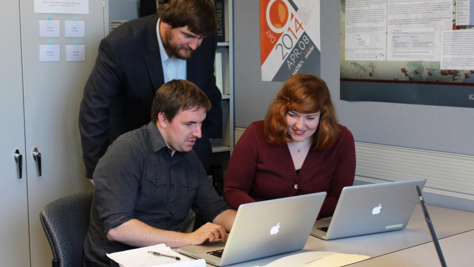 Students (from left) Kevin McMullen, Brian Sarnacki and Rebecca Ankenbrand work in the Center for Digital Research in the Humanities incubator in fall 2014. The CDRH is celebrating its 10th anniversary in April.