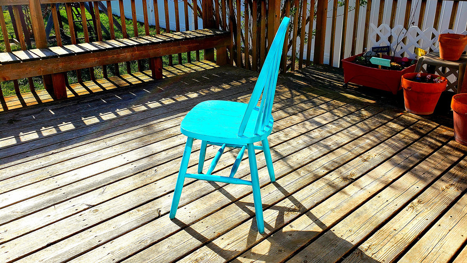 A view of Lisa Kort-Butler's bright, cheerful backyard deck — complete with a chair that offers a respite from COVID-19 related stress — has earned the Husker Home Office honor for the week of May 1.