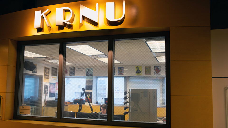 A student works inside the College of Journalism and Mass Communications' KRNU studio. The station is located in Andersen Hall.