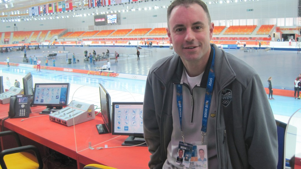 UNL alumnus Kevin Kugler sits in the Adler Arena Skating Center prior to announcing long track speed skating the 22nd Winter Olympics in Sochi, Russia. This is the fourth Olympic games Kugler has worked.