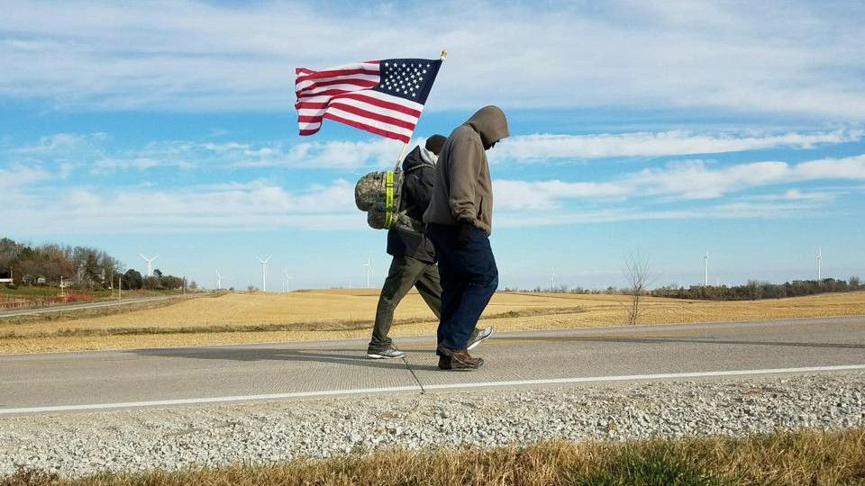 Volunteers on team Nebraska walk a stretch of highway as part of the veteran suicide awareness ruck march to Iowa City.