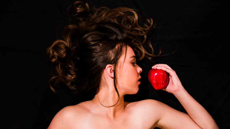 """""""The Serpent"""" cast member Kami Cooper poses with an apple. The Nebraska Repertory Theatre production opens Nov. 3."""