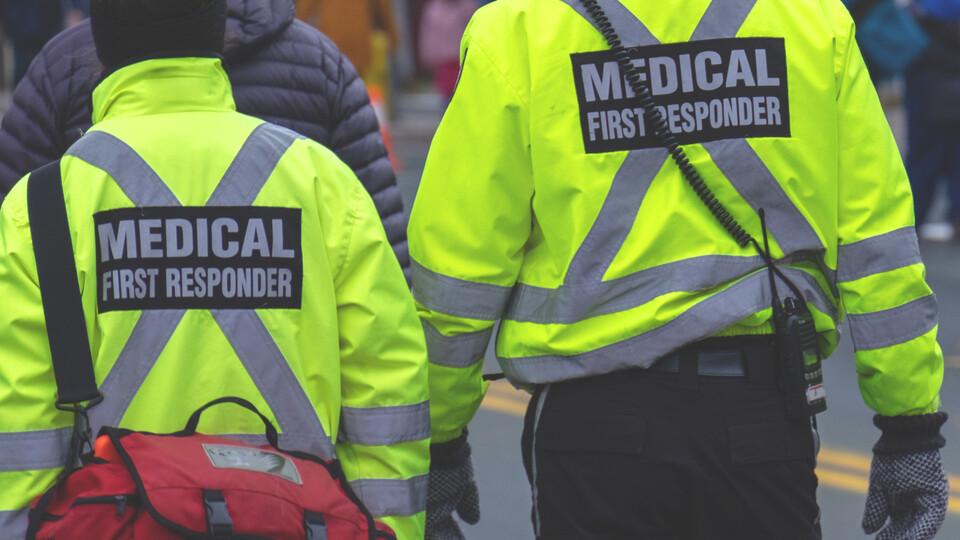 Emergency Medical Technicians approach a scene.
