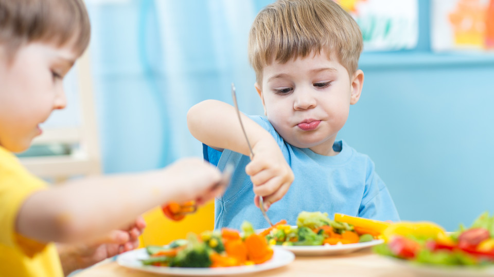 New research shows kids more likely to eat their veggies if they produce and see posters about healthy eating.