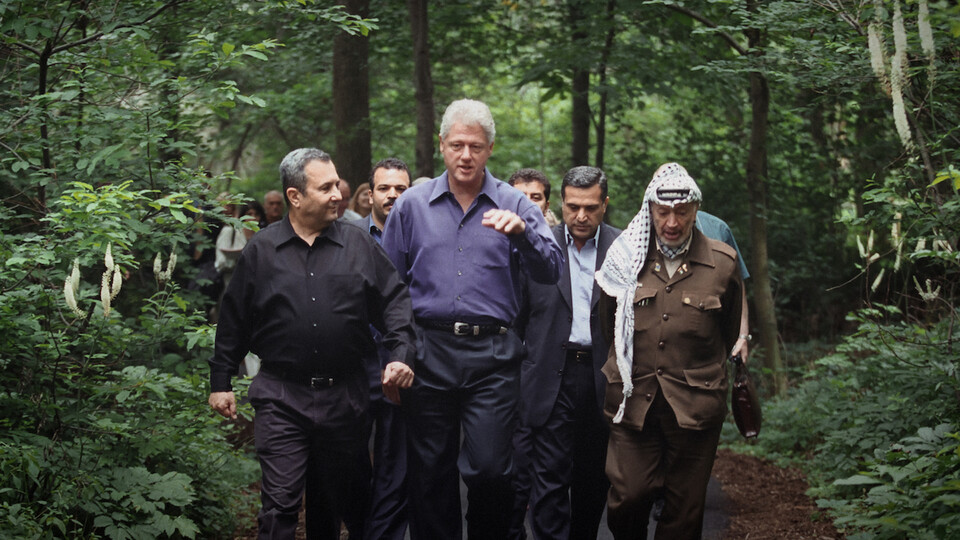 """Leaders (front, from left) Ehud Barak, Bill Clinton and Yasser Arafat walk during Israeli-Palestinian peace talks at Camp David in July of 2000. The failed talks — and negotiations that led up to them — are featured in """"The Human Factor,"""" which opens June 11 at the Ross."""