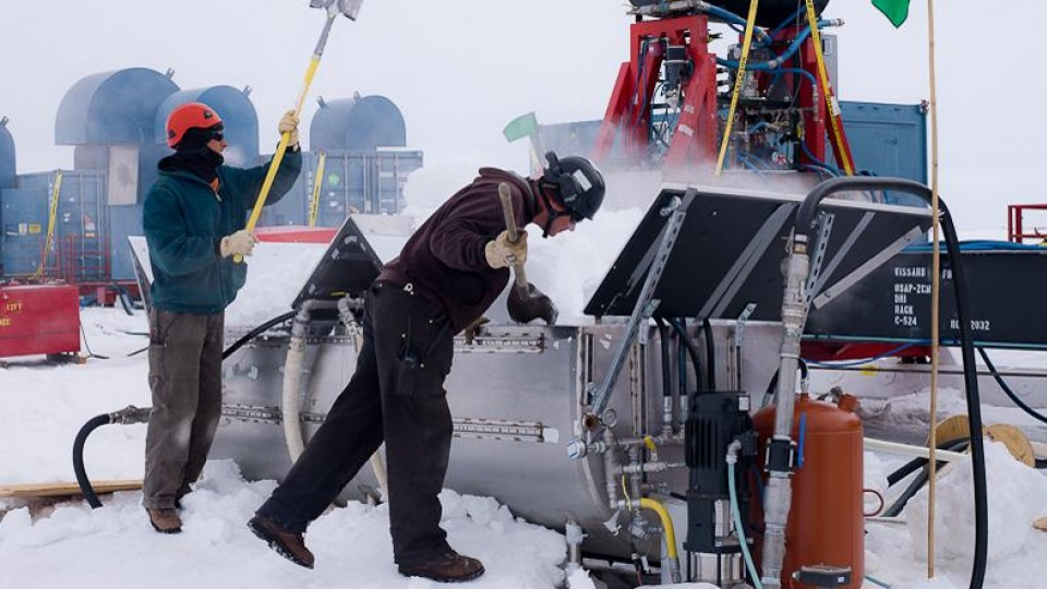 UNL drillers Daren Blythe and Dar Gibson shovel snow into a melter that provides water for the hot water drill that melted a hole through 800 meters of ice on top of subglacial Lake Whillans.