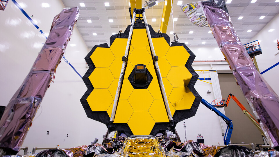 Set to launch on Dec. 18, NASA's James Webb Space Telescope will allow scientists to investigate the universe in the infrared, a band of light invisible to the human eye.