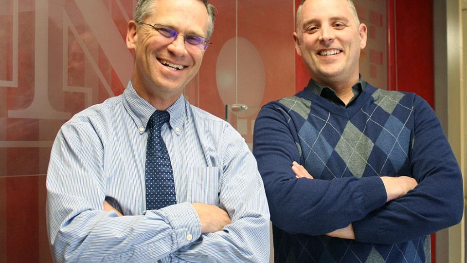Photo of Richard Bischoff, chair of child, youth and family studies (left) and Paul Springer, associate professor.