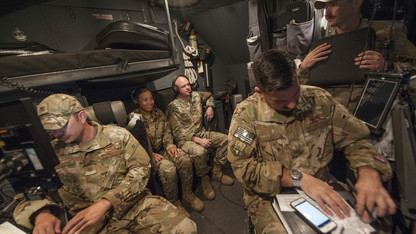 Hollist takes to skies to help military forces