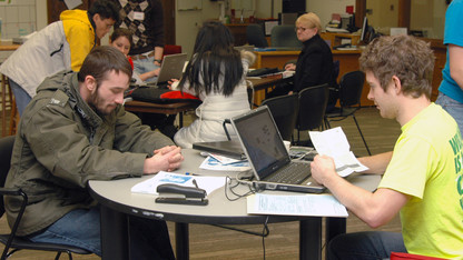 Volunteers assist with free tax prep service