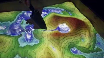 Augmented-Reality Sandbox to Boost Education & Outreach