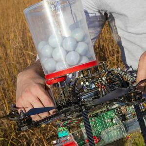 A new drone developed by UNL researchers can carry specialized plastic spheres that can be used to reduce the dangers associated with setting range fires.