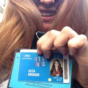 Aliza Brugger shows her Cannes Film Festival credentials. Brugger and five others from UNL worked in the American Pavilion during the event.