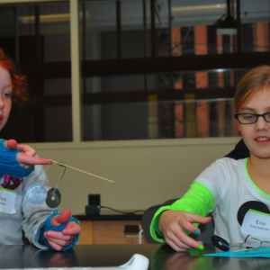 Lincoln Public Schools fifth graders (from left) Alora Schneider and Erin Geschweder build balance toys during Saturday Science on Feb. 1.
