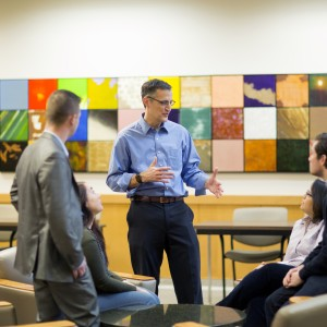 Richard Moberly, interim dean of the University of Nebraska's Law College, talks with students in McCollum Hall. The college is partnering with other Nebraska universities to recruit incoming college freshmen from outstate Nebraska to pursue legal careers.
