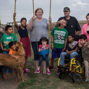 Nora and Randy Boesem have adopted 12 children suffering from fetal alcohol spectrum disorder. Since 2001, the Boesems have taken in more than 100 foster children. Boesem family members pictured are (from left) Rachel (15), Jeremy (10), Mark (4), Frannie (12), Nora, Dontae (14), Randy, Kayleigh (10), A.J. (10), Michelle (15) and Arianna (5) in the middle. Not pictured is Vincent (24), the late baby Justice and the late Donovan.