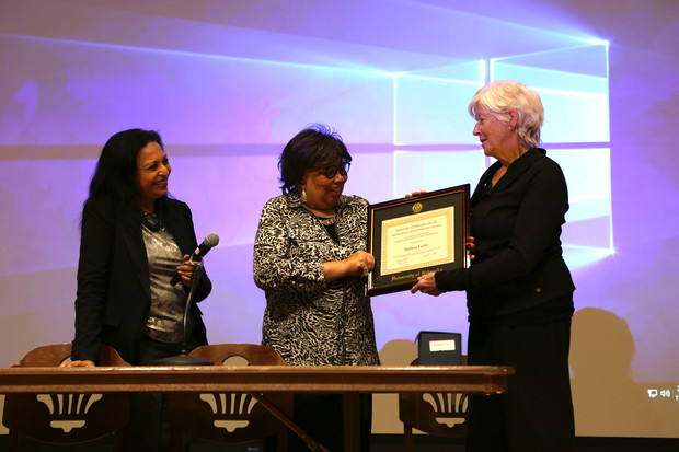 Dr. Melissa Farley is presented with the Prem Paul Award for Research in Anti-Human Trafficking by Anna Shavers and Sriyani Tidball.