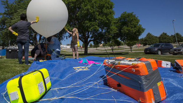 Nebraska's Michael Sibbernsen and students from Metropolitan Community College prepare a high-altitude balloon for launch on June 24. The launch was a test run for a NASA-funded project for the solar eclipse on Aug. 21.
