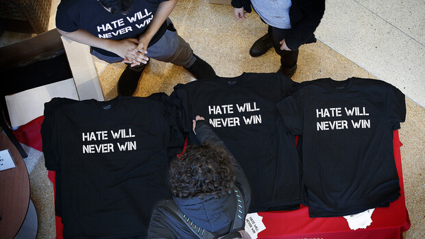 "Nebraska students hand out ""Hate Will Never Win"" T-shirts in the Jackie Gaughan Multicultural Center before a campus rally in February 2018."