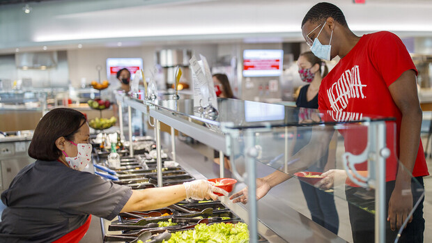 All masked up, students make lunch selections in the Cather Dining Center earlier this summer. In a July 23 email, Chancellor Ronnie Green outlined a number of safety protocols — including the use of facial coverings — that the university community will f