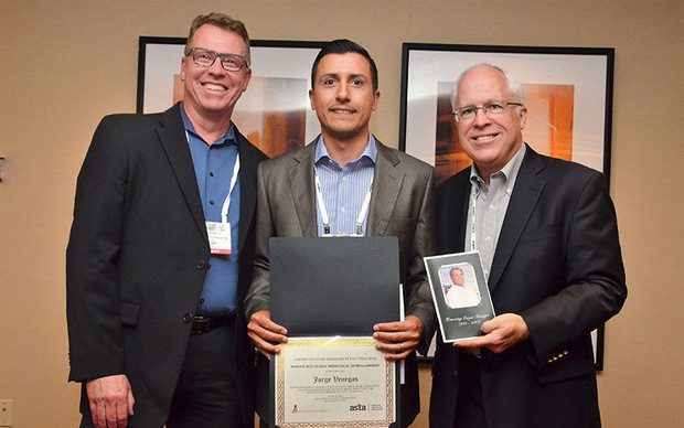 Jorge Venegas (center) receives the Roger Krueger Memorial Scholarship from Glenn Austin of the Monsanto Company (left) and Jim Tobin of the American Seed Reseach Foundation, at the American Seed Trade Association conference June 22 in Minneapolis.