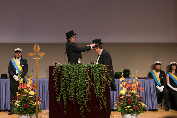 Cahoon receives doctoral hat during graduation ceremony.
