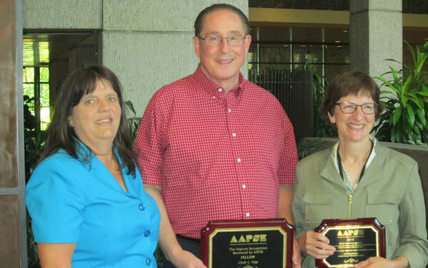 Nebraska's Clyde Ogg (center) and Jan Hygnstrom (right) received national awards from the American Association of Pesticide Safety Educators. Also pictured is Kerry Richards, president of the association.