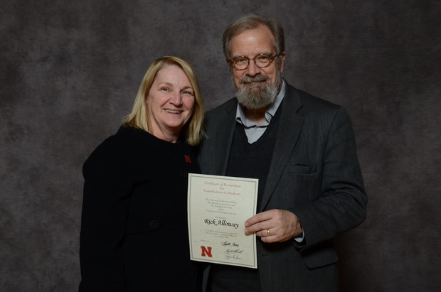 Amy Struthers, interim dean of the College of Journalism and Mass Communications, with 25-time award recipient Rick Alloway.