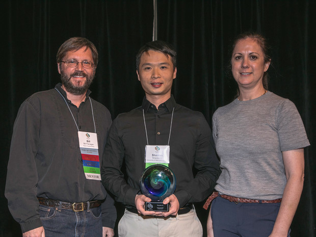 Nebraska's Shaobin Li (center) receives the Student Life Cycle Assessment Leadership Award from American Center for Life Cycle Assessment representatives Bill Flanagan (left) and Debbie Steckel (right).