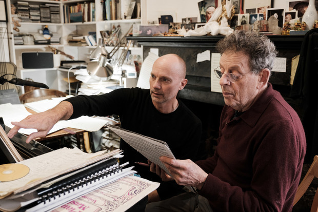 "Paul Barnes (left) and Philip Glass review the score for ""Annunciation."""
