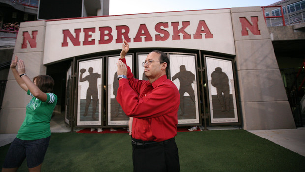 Juan Franco signals the start of the Big Red Welcome tunnel walk in Memorial Stadium.
