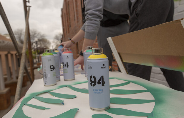 To create the mural, students used spray paint (the same kind used by many street artists) and hand-cut stencils. The patterns repeated multiple times in the 20-foot by 20-foot square mural.