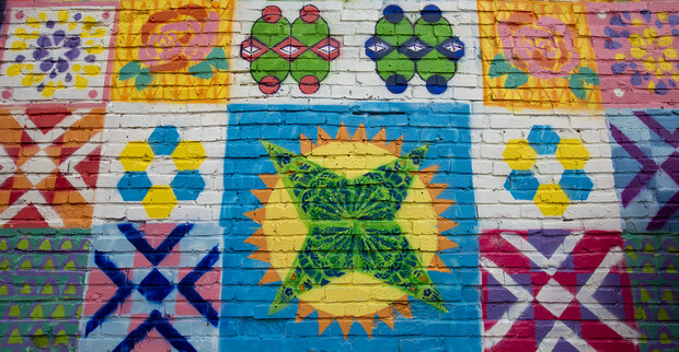Detail of the mural students created in Lincoln's historic Havelock neighborhood on April 17. Each block is two-feet square.
